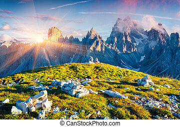 Colorful summer sunrise of the Cadini di Misurina range in...
