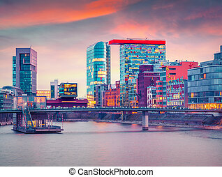 Colorful spring sunset on Rhine river in Dusseldorf.