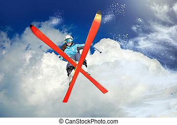 skier - A female skier on the piste in Alps, Europe