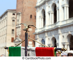 italian flag of army musical band and the Palladian Basilica...