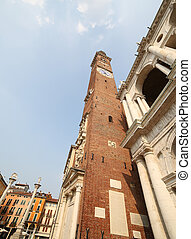 high clock tower of the Palladian Basilica in italian city