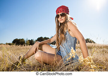 Hippie girl sitting on a meadow - morning shot - Beautiful...