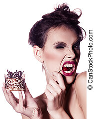 young woman eat tasty cake