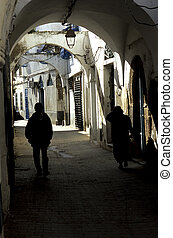 Tunisian medina - People walking in the maze of alleyways...