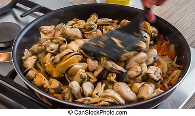 Cooking mussels - process of preparing seafood: mussels...