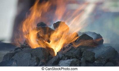 Glowing hot embers - Hot burning embers in brazier, closeup