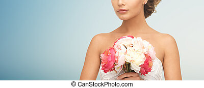 bride or woman with bouquet of flowers - wedding, holidays,...