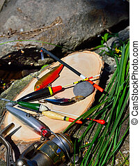 fishing tackle against the backdrop of the stone