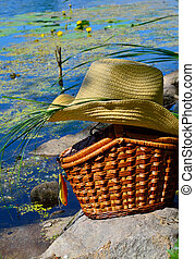 Wicker basket, wobbler and hat against