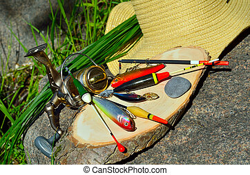 fishing tackle with wicker basket and hat