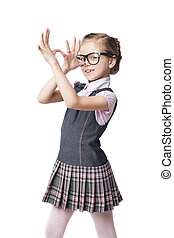 Funny little girl in glasses makes faces - Portrait of a...