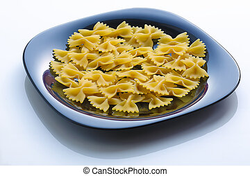 pasta in a black plate on white