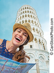 Closeup of laughing female tourist holding map in Pisa -...