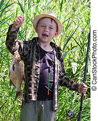 Young fisherman caught a bream - Young fisherman caught fish...