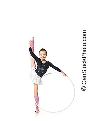 Beautiful little gymnast with the hoop isolated on white...
