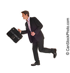 Businessman running - A running businessman in a dark suit...