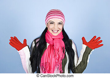 Excited woman in winter clothes