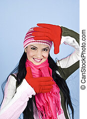 Happy winter woman face - Happy winter woman framing face...