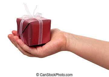 child holding a gift - child\'s hand and gift over white...