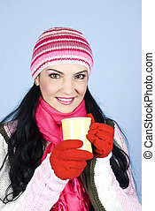 Happy winter woman with hot drink