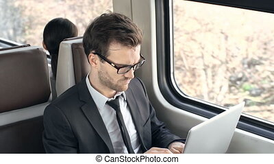 Busy Working - Close up of smart businessman commuting on a...