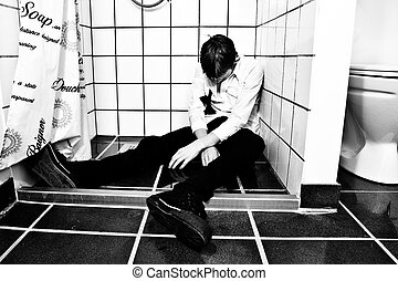 Drunk and unconscious boy in shower - Dressed for party,...