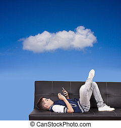 child on the couch with mobile phone