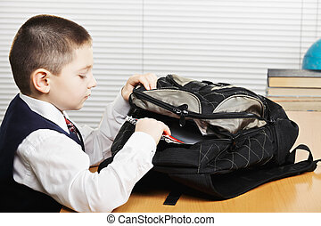 Schoolboy taking out books - Schoolboy taking books out of...