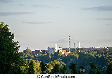 Powerplant seen in distance surrounded by nature. Symbol of...