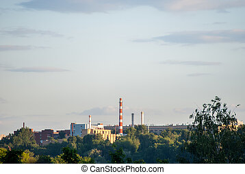 Powerplant seen in distance surrounded by nature Symbol of...