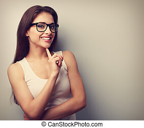Happy successful smiling young woman in glasses thinking...