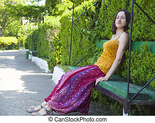 A woman dressed in Oriental style fun in the Park - Young...