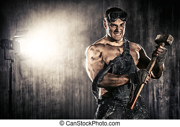 rage of a worker - Strong aggressive coal miner with a...