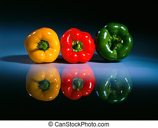 Three colored pepers on a table 2 - Three fresh colored...