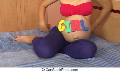 7 seventh pregnancy month - Pregnant woman with girl word on...