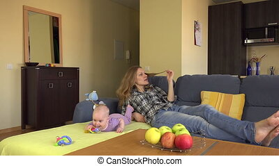 nanny baby angry father - Relaxed nanny mother lay on sofa...