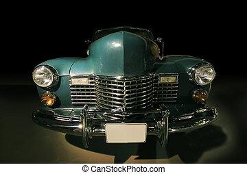 ancient car against dark background