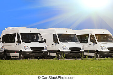 minibuses and vans outside - number of new white minibuses...