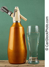Old vintage siphon and glass of water - Old vintage aluminum...