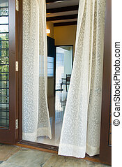 Sheer Curtains - Sheer curtains outside a room