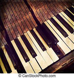 Keys of a broken antique piano, retro style photo.