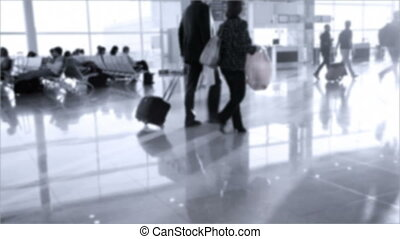 Passengers with luggage walking in modern Zurich-Kloten...