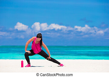 Healthy athlete woman working out doing exercise on tropical...