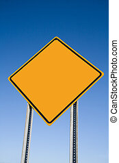 Caution Sign - Blank Caution sign with blue sky background.