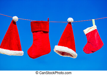 Red Santa hats and Christmas stocking hanging background...