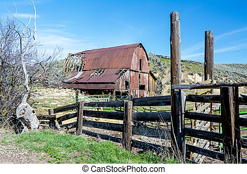 Classic barn and corral fence - Red rusted barn and...