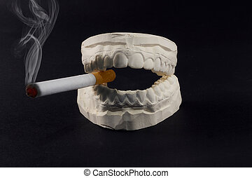 teeth and cigarettes - A cigarette in his mouth that harms...