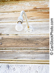 Front porch light from an abandon building - Old light bulb...