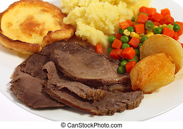 Beef dinner - Close-up on a plate of roast beef, yorkshire...
