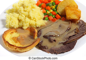 Roast beef dinner - Close-up on a plate of roast beef,...
